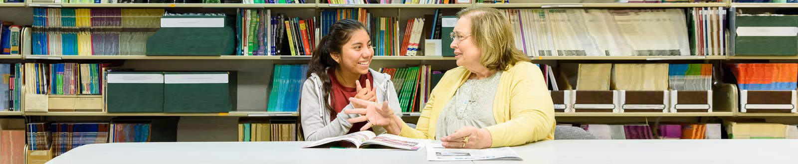 Older lady mentoring younger female student