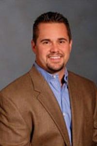 Justin E. Ausherman